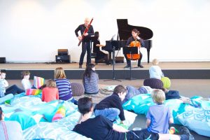 Children sit on mats at the Sensory Concert in Glenbrook, Blue Mountains